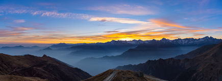 Mountain silhouette and stunning sky at sunset, panorama Stock Image