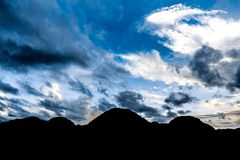 Mountain silhouette in Viñales valley view in Cuba. Unreal nature with lakes, mountain, trees, wildlife. Gorgeus sky. Viñales valley view in Cuba. Unreal Stock Images