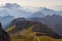Mountain silhouettes in the Julian Alps, Slovenia, at sunset, in a warm late Summer day. As seen comming down from Mangart peak royalty free stock photos