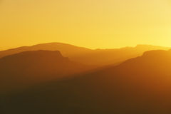 Mountain silhouettes at sunset Stock Photo
