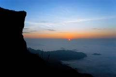 Mountain silhouettes, Sunset in Chiang Rai, Thai. Geology. In northern Thailand. Sunset on the mountain. Mountain valley filled with fog. Sunrise at Phu Chi Fa Stock Photography
