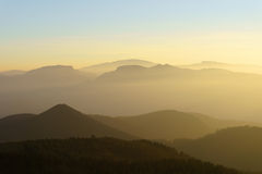 Mountain silhouettes at sunset with haze. Mountain silhouettes at the sunset with haze Royalty Free Stock Photos
