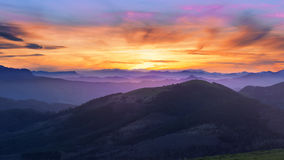 Mountain silhouettes at sunset Stock Image