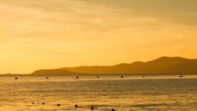 Mountain siluette at sunset. Anchored archipelago background beach blue boat burn caribbean cartagena chonburi coast Stock Photography