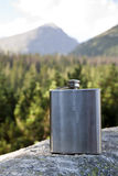 Mountain and silver flask Royalty Free Stock Image