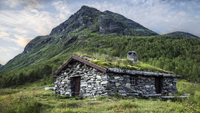 Mountain and a simple hut Stock Image