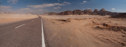 Mountain in the Sinai desert and roads. Later afternoon light on a remote sandy desert royalty free stock photos