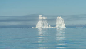 Mountain-size icebergs floating near the mouth of the Icefjord, Stock Photo
