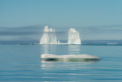 Mountain-size icebergs floating near the mouth of the Icefjord, Royalty Free Stock Photography