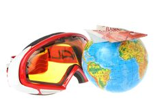 Mountain ski mask, globe and airplane of money on it Stock Images