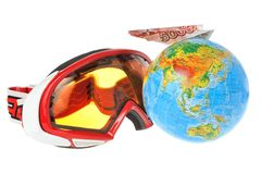 Mountain ski mask, globe and airplane of money on it Royalty Free Stock Photo