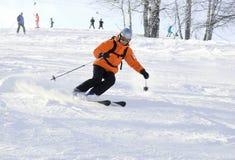 Mountain ski rider. In orange closeup Royalty Free Stock Photo