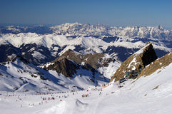 Mountain ski slope glacier austria with skiers. Mountain ski slope on glacier in austria with skiers skiing downhill and cable transportation systems Stock Photography
