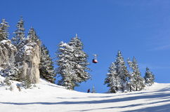 Mountain ski slope, skier and cable car Stock Images