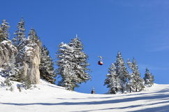 Mountain ski slope, skier and cable car stock image