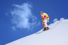 Mountain skier. Bright winter day. The mountain skier moves down downhill royalty free stock images