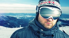 Mountain-skier closeup. Mountain-skier weared sport goggle closeup Stock Photo