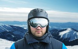 Mountain-skier closeup. Mountain-skier against mountain with reflection in googles Stock Photo