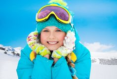 Mountain skier girl. Mountain skier ten years old girl laying in snow with mountains on background Stock Photography