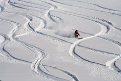 Mountain skier go down on powder snow. Stock Images