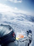 Mountain-skier jump. From back view Stock Photo