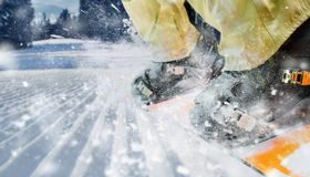 Mountain-skier legs closeup. Mountain-skier boots in motion closeup Stock Photography