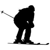 Mountain skier speeding down slope. Vector sport silhouette Royalty Free Stock Image