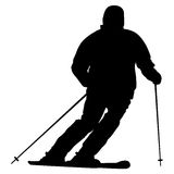 Mountain skier speeding down slope. Vector sport silhouette Stock Photos