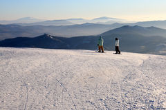 Mountain-skiers on the top of mountain. Royalty Free Stock Images