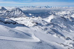 Mountain skiing - panoramic view at the ski slopes and Cervinia, Italy, Valle d`Aosta, Cervinia Stock Image