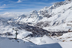 Mountain skiing - panoramic view at the ski slopes and Cervinia, Italy, Valle d`Aosta, Cervinia Royalty Free Stock Photo
