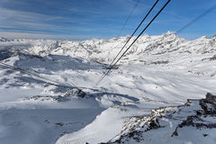 Mountain skiing, Plateau Rose - panoramic view from the cable car at the ski slopes and Cervinia, Valle d`Aosta, Breuil-Cervinia, Stock Photography