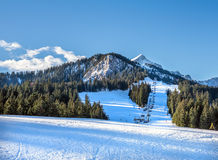 Mountain skiing slopes and ski lift at Hausberg top near Garmisc Stock Photos