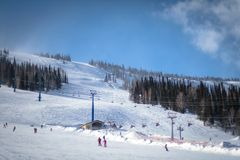 Mountain skiing view with people Stock Images