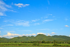 Mountain and sky. Green meadow in mountain. Composition of nature stock photos