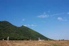Mountain and sky. Green mountains with blue sky in the background Royalty Free Stock Images