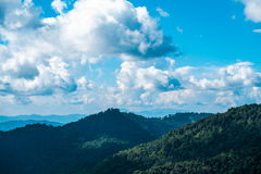 Mountain and sky. Mountains landscape summer green blue grass sky nature beauty travel scene, valley color view hill range white bright sunny day outdoors nobody Royalty Free Stock Photography