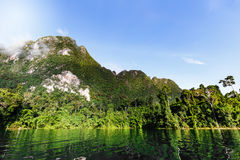 Mountain and sky over lagoon Royalty Free Stock Photo