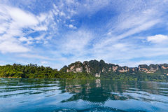 Mountain and sky over lagoon Royalty Free Stock Images