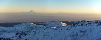 Mountain Aragats Armenia clouds sky. Mountain sky peaks snow sun blue snow Armenia Caucasus sky Royalty Free Stock Image