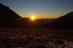 The Sun over Mountain Aragats Armenia. Mountain sky peaks snow sun blue snow Armenia Caucasus sky Sun Royalty Free Stock Image