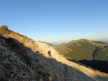 Mountain, sky and shadow of a man. In epirus Greece Royalty Free Stock Photos