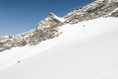 Mountain slope covered with snow Stock Photo