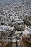 Mountain slope with a crumbling natural stone Royalty Free Stock Photography