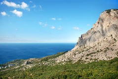 Mountain slope that descends to the sea Stock Photography
