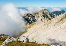 Mountain slope finishing with a steep ridge. Stock Photography