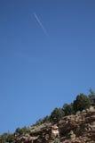 Mountain Slope and Jet Airplane Stock Photos