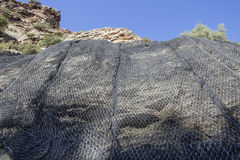 Mountain slope reinforced metal protective mesh, Spain Stock Image