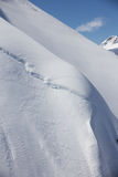 Mountain slope and snow cornice Stock Photography