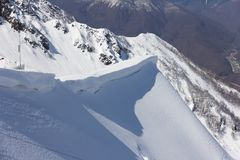 Mountain slope and snow cornice Stock Photo